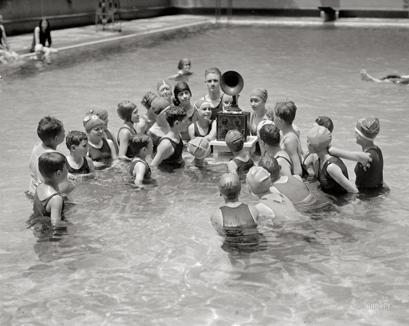 children-listening-to-radio-in-swimming-pool-ca-1920s