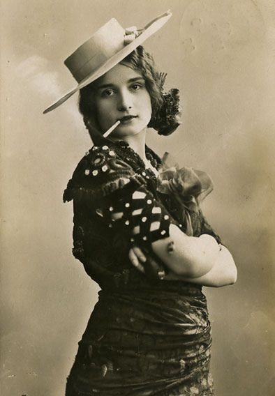 woman-with-arms-crossed-and-cigarette