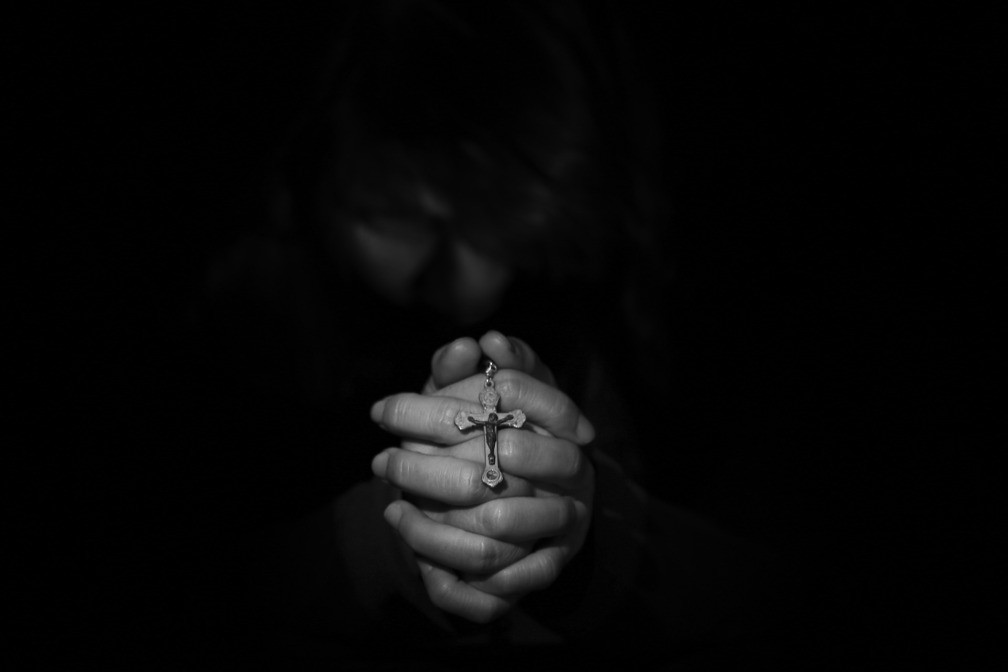 This is a picture of a sorrowed man praying. I've chosen this image because it augments my villanelle which is about grief